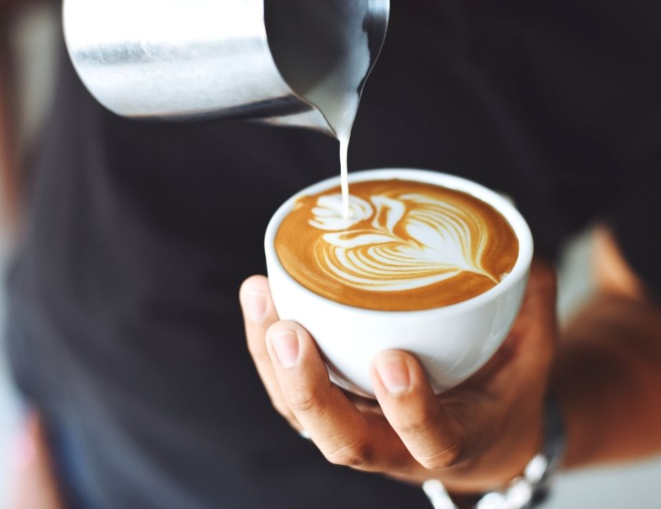 steamed milk being poured into latte at a cafe, Living in Glendale, Living in Phoenix real estate