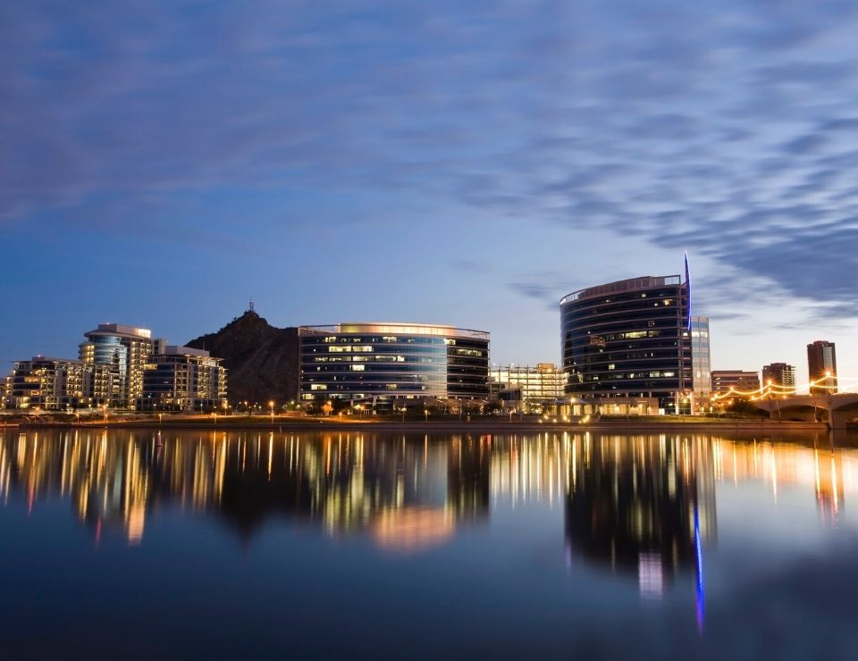view of Tempe Arizona at night over water, best suburbs to move to in Phoenix Arizona