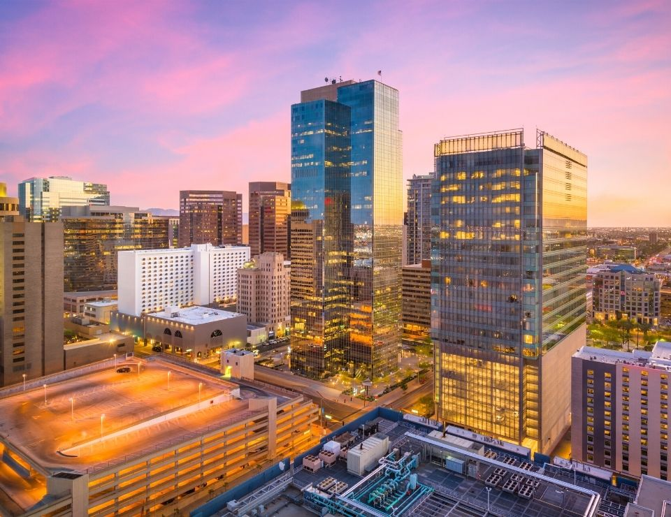 downtown Phoenix with a colorful sunset sky, Reasons why everyone is moving from CA to Phoenix