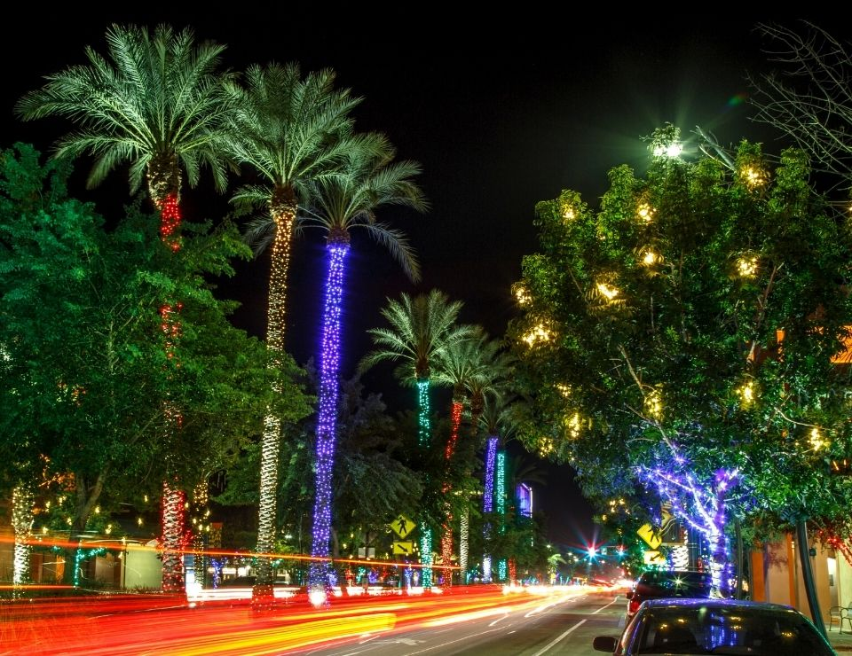 main street in Chandler AZ at night with lights, Living in Scottsdale vs Chandler Arizona